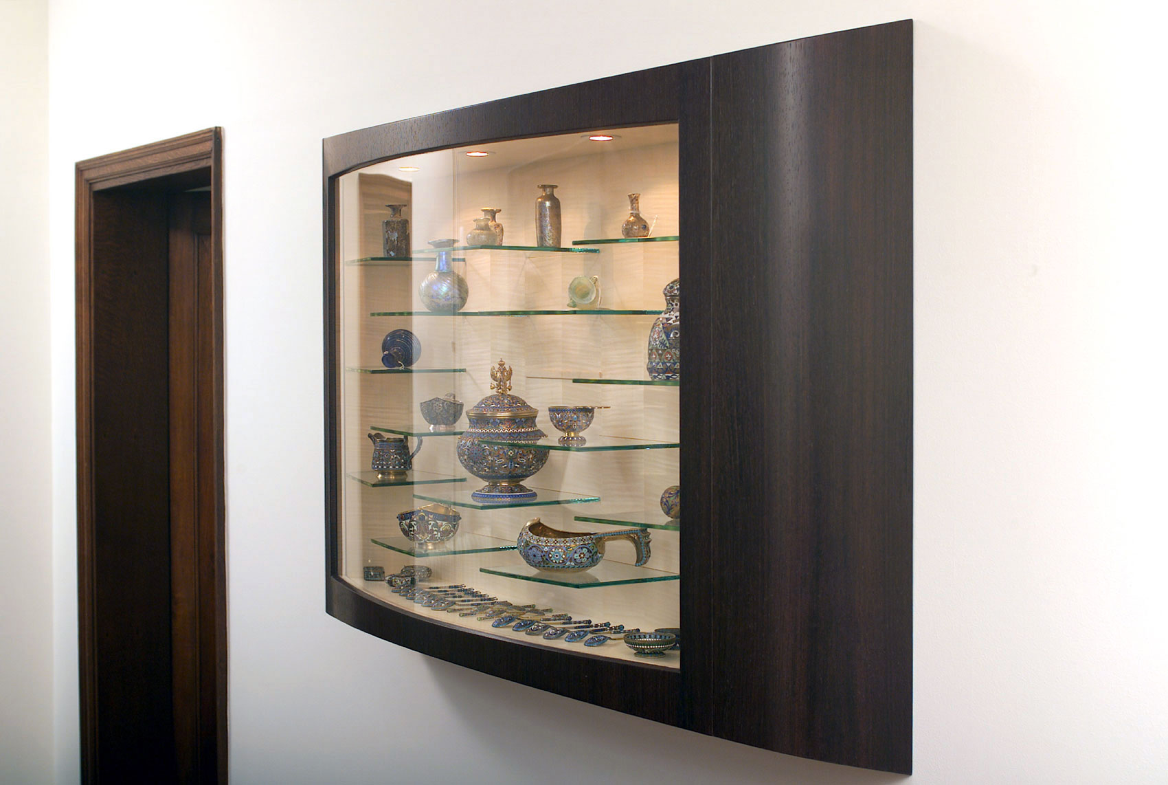 A cabinet to store and display the client's collection of ceramics