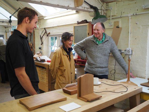warren-bentley-shows-examples-of-apprentice-work-to-visitors